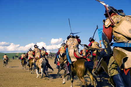 independent mongolia: Crowd of fully armored soldiers reenacting historical event.