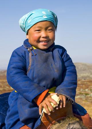 independent mongolia: Young Tsaatan girl with a beautiful smile (reindeer people), northern Mongolia.