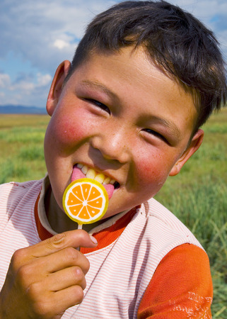 independent mongolia: Happiness Asian boy with his candy. Stock Photo