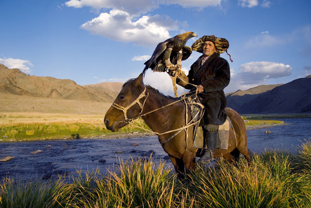 independent mongolia: Kazakh men traditionally hunt foxes and wolves using trained golden eagles. Olgei,Western Mongolia.  I have been fortunate to have witnessed many beautiful locations as a photographer. When shooting Fine Art stock or authentic travel photography I endeavo