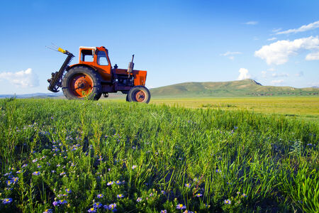 Side view of a Ttractor in a scenic view. photo