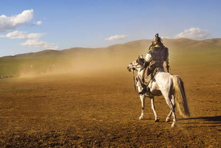 independent mongolia: Lone man staring at the crowd of soldiers from afar.