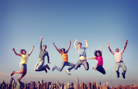 diverse teens: Cheerful People Jumping Friendship Happiness City Concept