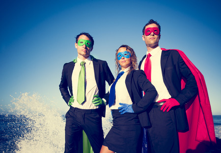 strong team: Business superheroes facing storm.
