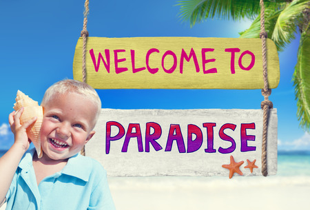 welcome sign: Little Boy Holding a Seashell with Welcome Sign Stock Photo