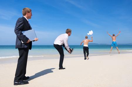 Businessman enjoying him self on the beach. photo