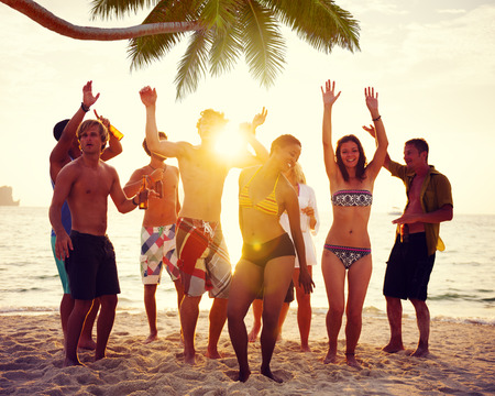 Diverse People Dancing and Partying on a Tropical Beach photo