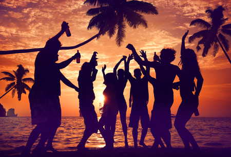 sunny beach: Silhouettes of Diverse Multiethnic People Partying Stock Photo
