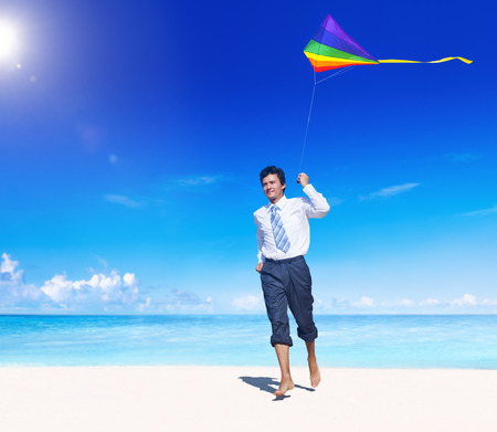 Businessman relaxing on the beach. photo