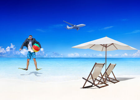 getting away from it all: Businessman by the Beach Getting Away From it All