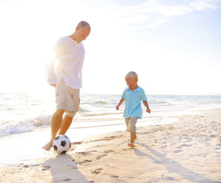 Father and son playing football together. photo