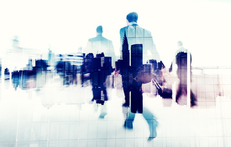Business People Walking on a City Scape Stock Photo