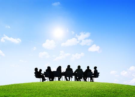 Group of business people having an outdoor meeting. Banco de Imagens
