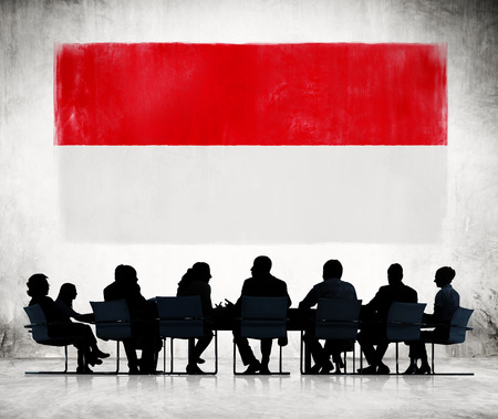 indonesia culture: Silhouettes of Business People and a Flag of Indonesia