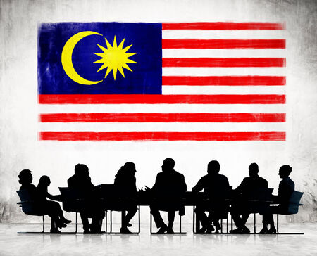 malaysia culture: Silhouettes of Business People and a Flag of Malaysia