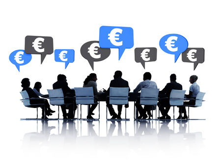 Silhouettes of group of business people discussing Euro around the conference table in white background. photo
