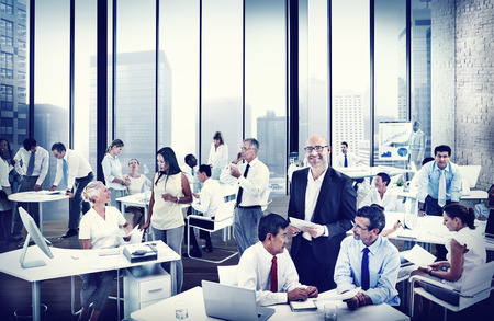 BUSY PERSON: Multiethnic Group of People Working in the Office