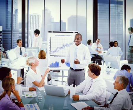 Diverse Business People Listening to a Business Presentation