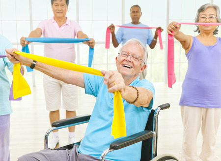 Exercising: Group of Healthy People in the Fitness