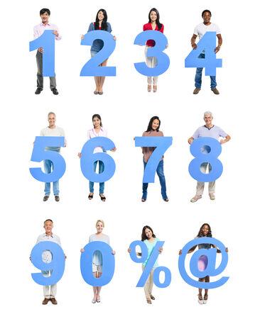 numero nueve: Grupo de personas que tienen Azul numeral en una fila Foto de archivo