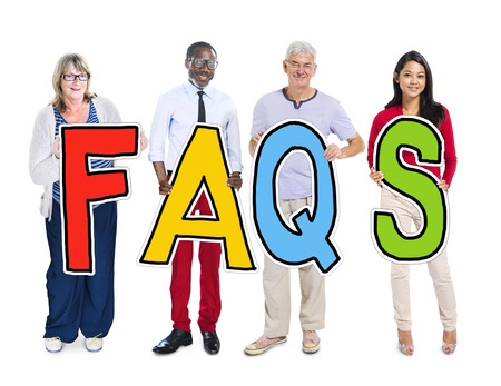 faq's: Group of People Standing Holding FAQS Letter