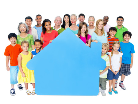 Large Group of People Holding Home Symbol Stock Photo