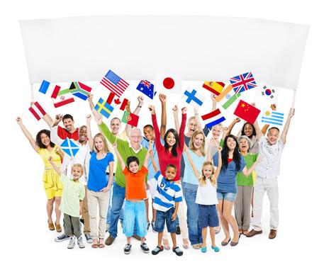 Groep van multi-etnische groep mensen met lege billboard En Nationale Vlaggen Stockfoto - 35330636