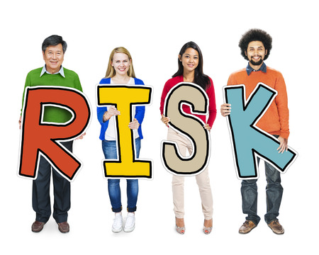 inconstant: Group of People Standing Holding Risk Letter Stock Photo