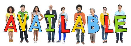 achievable: Group of People Standing Holding Available Letter Stock Photo
