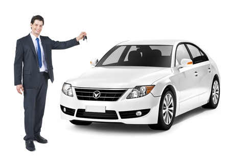 new automobiles: Business Man Holding a Key of the White Car Stock Photo