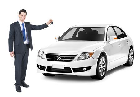 homme détouré: Homme d'affaires tenant une clé de la voiture blanche