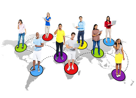 Multi-ethnic people social networking via modern technology. Stock Photo