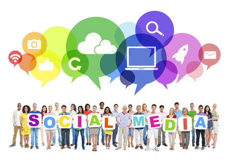people network: Multi-ethnic group of people holding cardboards forming social media and related symbols in speech bubbles above.