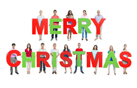 Multi-ethnic group of people holding MERRY CHRISTMAS letters photo