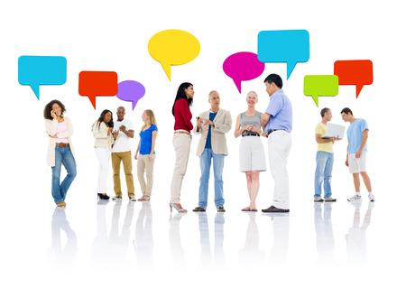 Grupo multimisión étnica de gente hablando y utilizando equipo de comunicación Foto de archivo - 35332495