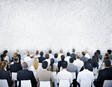 Multiethnic Group of Audiences with Brick Wall