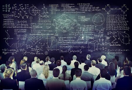 Multiethnic Group of People with Formula on Chalkboard photo