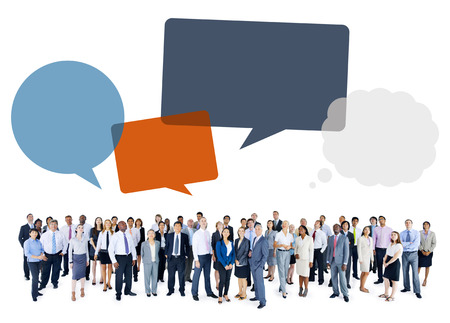 woman looking up: Multiethnic Group of Business People with Speech Bubbles Stock Photo