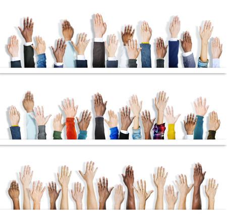 hands raised: Multiethnic Group of Hands Raised