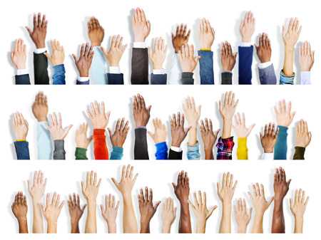 hands raised: Group of Multiethnic Diverse Hands Raised Stock Photo