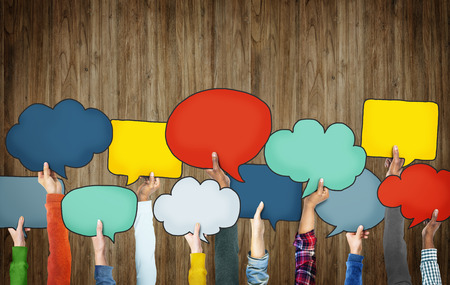 bubble speech: Group of Hands Holding Speech Bubbles Stock Photo