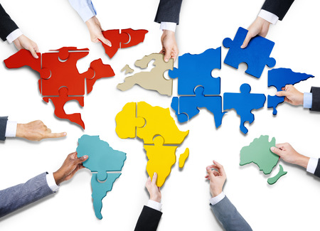 hands holding earth: Group of Business People with Jigsaw Puzzle Forming in World Map