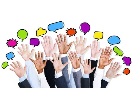 Business peoples arms raised with speech bubble photo