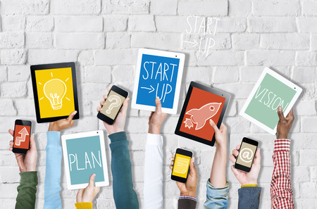 social media: Group of Hands Holding Digital Devices with Startup Concept