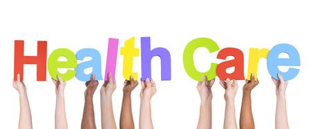 Group of Multiethnic Hands holding Health Care Standard-Bild