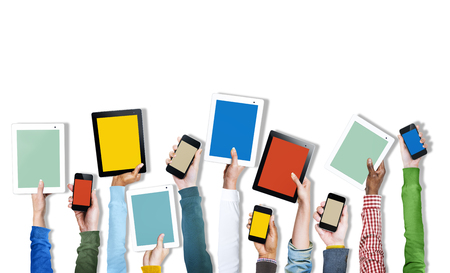 Group of Diverse Hands Holding Digital Devices photo