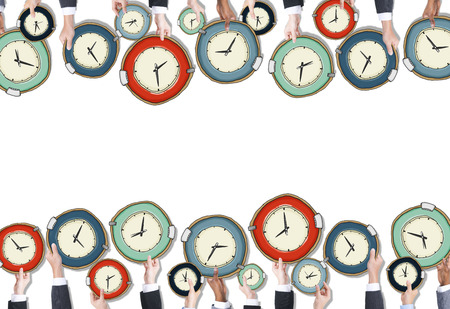 Group of People Holding Clocks