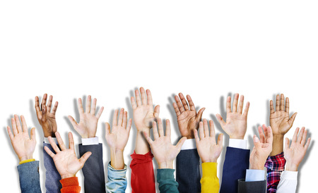 Group of Multiethnic Diverse Colorful Hands Raised Фото со стока