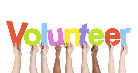 volunteering: Diverse Hands Holding The Word Volunteer