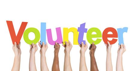 Verschiedene Hände halten die Wort-Volunteer Standard-Bild - 35334421